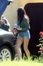 Nina Dobrev In shorts outside her house after shopping in LA
