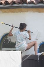 Nina Dobrev Seen paiting her house in Los Angeles