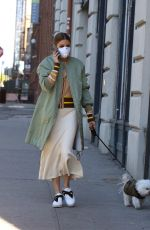 Olivia Palermo Wearing a mask, as she takes her dog for a walk in a park in Dumbo
