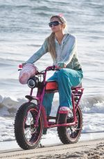 Paris Hilton Goes for a cruise with her boyfriend Carter Reum on the beach in Malibu