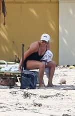 Penny Lancaster Takes a little time for herself and relaxes at the beach today outside of quarantine lockdown in West Palm Beach
