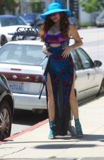 Phoebe Price Poses for pictures as she sells face masks on the street in Hollywood