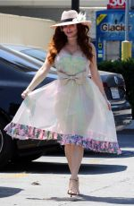 Phoebe Price Poses outside a Ralph