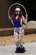 Phoebe Price Seen stretching and playing around with a hula hoop