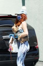Phoebe Price Wearing a mask and gloves goes to Petco for dog food