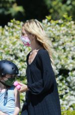 Rachael Zoe Takes her kids for a ride and exercises wearing sliders in Beverly Hills