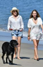 Robin Wright & Dylan Penn Walking their dogs on the beach in Malibu