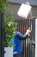 Sara Sampaio Greets the delivery guy in a bikini top as she bravely excepts her lunch during the safer at home in Los Angeles