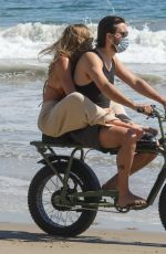 Sofia Richie Holds on tight to Scott Disick as they have some fun riding a motorbike on the beach