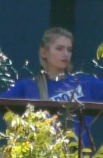 Stella Maxwell Hangs fairy lights as she has friends over to celebrate her 30th birthday in Los Angeles