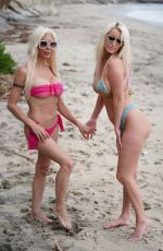 Tiffani Madison & Frenchy Morgan Share a little affection as the happy couple walk on the beach in Malibu