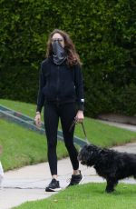 Troian Bellisario Out for a walk with her daughter and their dog in Los Angeles