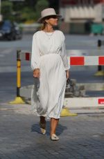 Vogue Williams In a white dress and fedora as she leaves Heart Radio breakfast show in London