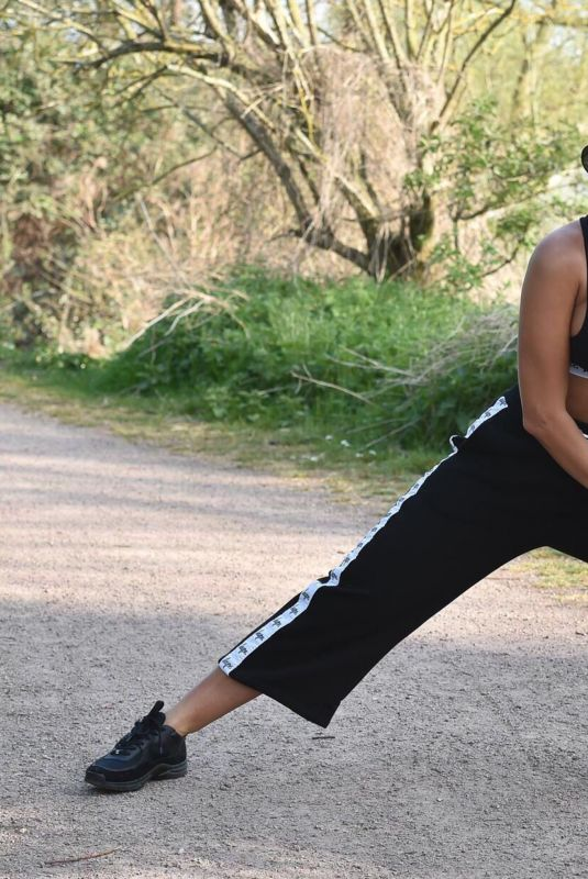 Yazmin Oukhellou Stretching in a park in Essex