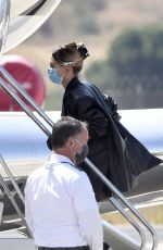 Bella Hadid & Hailey Bieber Are seen on their way home from Sardinia after a 3 day photo shoot for Versace, Sardinia