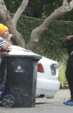 Blac Chyna Chats with a bodyguard while visiting a house in Beverly Hills