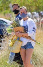 Brie Larson Shops for flowers at a farmer