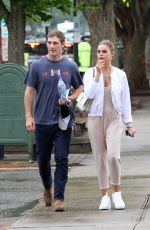 Brooks Nader and her husband William are phtographed walking in the Hamptons New York
