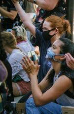 Camila Mendes and Madelaine Petsch attend a protest in LA