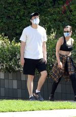 Charli XCX And boyfriend Huck Kwong protect themselves with face masks as they go for a walk in Los Angeles