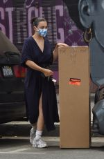 Charli XCX Drops off a large piece of artwork at a framing store in Los Angeles