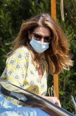 Cindy Crawford Wears a mask as she grabs her car from valet today after having lunch with her girlfriend in Malibu