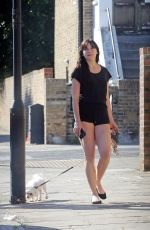 Daisy Lowe Walking her dog in London