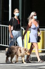 Daphne Groeneveld Walks her dog wearing a face mask during the Covid-19 Pandemic in New York City