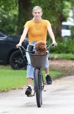 Devon Windsor Enjoys a bicycle ride with her pooch in Miami