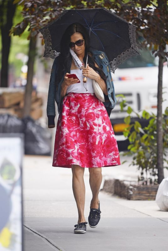 Famke Janssen Out and about wearing a bright summer skirt in New York