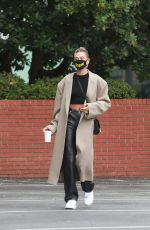 Hailey Bieber Looks stylish chic during a solo trip to Blue Bottle Cafe in Beverly Hills