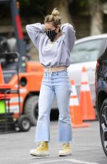 Hilary Duff Adjusts her designer mask before heading into Whole Foods in Los Angeles