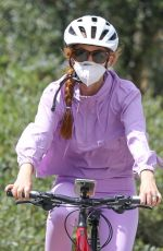 Isla Fisher Looking cute in all lavender during her daily bike sesh in Los Angeles