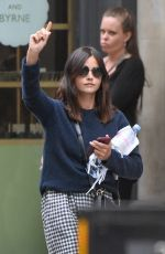 Jenna Coleman Seen flagging down a taxi while out running errands in Central London