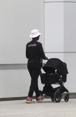 Jodie Turner-Smith Takes an afternoon stroll with her newborn while wearing a t-shirt against racism