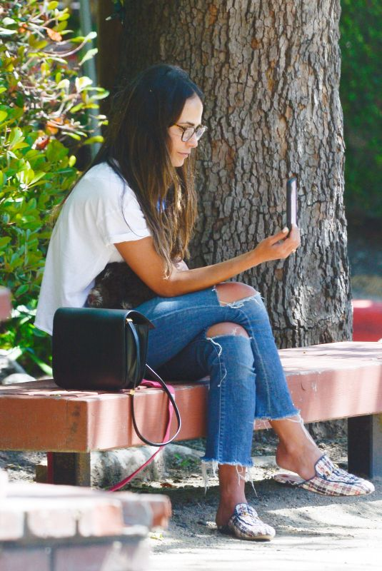 Jordana Brewster Cradles her pup while checking her phone in Los Angeles