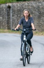 Kate Moss and daughter Lila Grace test their new electric bikes near their Cotswold home