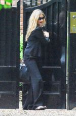 Kate Moss As she steps out this afternoon and gets in to a waiting car