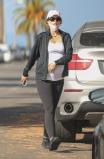 Katherine Schwarzenegger Rubs her baby bump while out on a walk in Venice beach