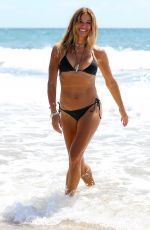 Kelly Bensimon Shows off her toned summer body in a skimpy Melissa Odabash two piece bikini in Deerfield Beach