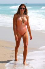 Kelly Bensimon Spotted on showing off her bikini fit body while enjoying the beach and ocean