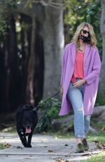 Laura Dern Seen walking her dog dressed in a nice purple jacket near her Pacific Palisades home