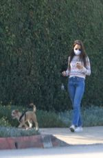Lily Collins Walking Redford in Beverly Hills