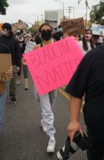 Madison Beer Marches with fellow protesters in Los Angeles