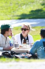 Margaret Qualley Takes a stroll through Pan Pacific Park with some friends in Los Angeles