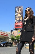 Megan Pormer Posing in front of her billboard on Sunset in Hollywood
