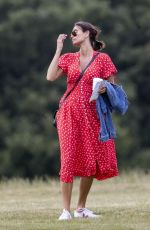 Melanie Sykes Looks stunning in a bright red summery dress as she