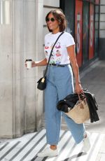 Melanie Sykes Looks youthful wears flared denim and trendy shades at BBC studios in London