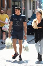 Molly-Mae Hague Cradles new Pomeranian pup Mr Chai as she enjoys a walk with boyfriend Tommy Fury in Manchester