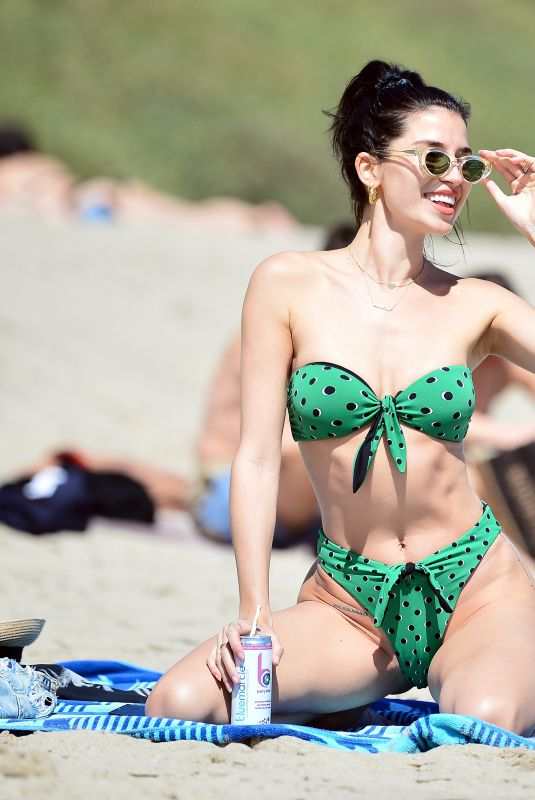 Nicole Williams Looks incredible as she sports a skimpy green Devon Windsor bikini during a day in Malibu